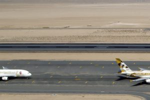 Etihad and Emirates Airbus A380s lineup.