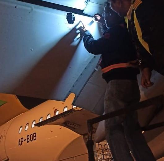 Airbus A320 being inspected by Air Sial engineers